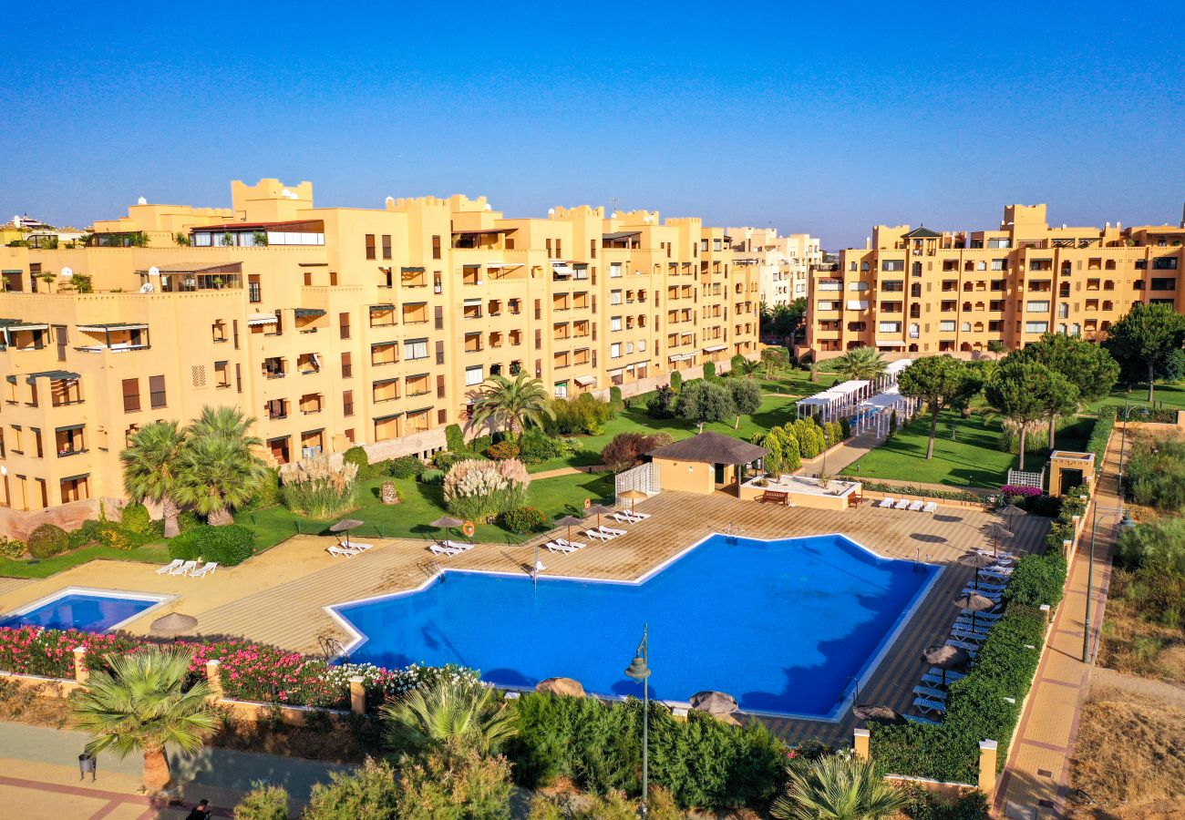 Apartamento en Isla Canela - Apartamento con piscina a100 mde la playa