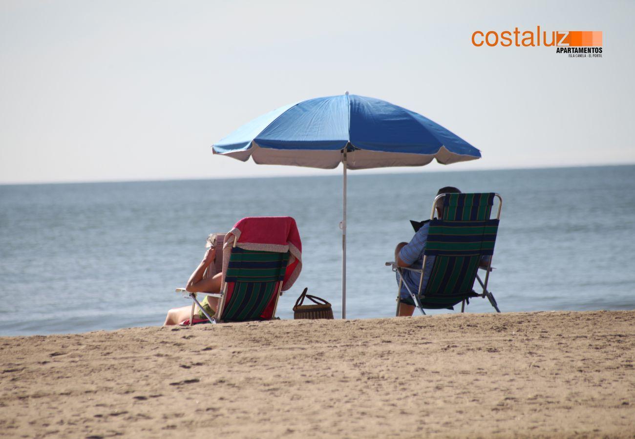Apartamento en Isla Canela - Apartamento con piscina a50 mde la playa