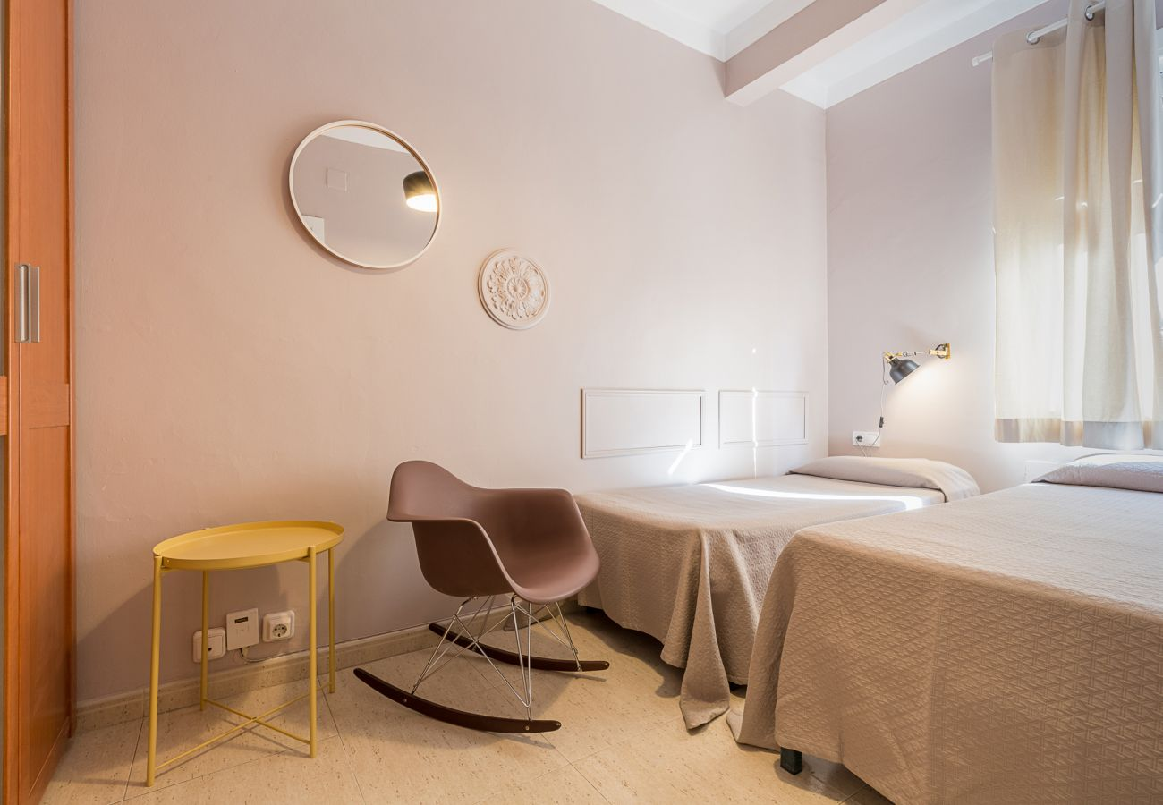 outside room with two single beds in the apartment plaza españa Barcelona