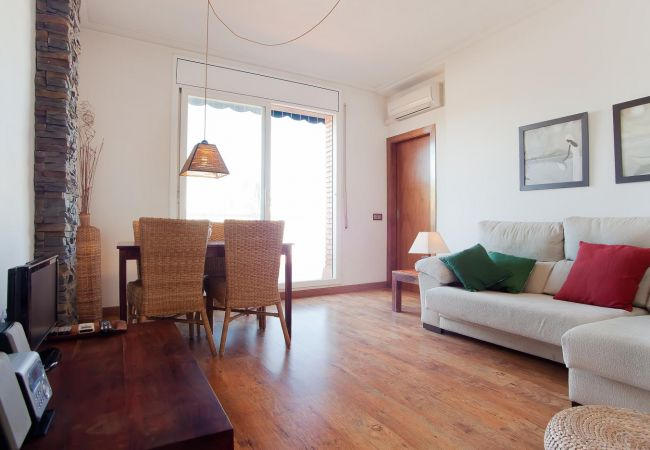 Spacious living room with access to the terrace with views of the Sagrada Família in Barcelona